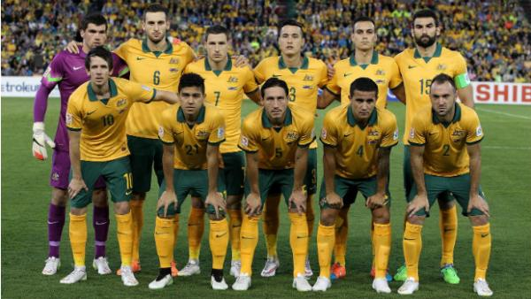 The Socceroos semi-final starting XI line up for their team shot before kick-off against UAE.