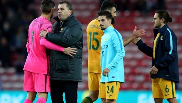 Ange Postecoglou embraces Maty Ryan following Australia's 2-1 loss to England.