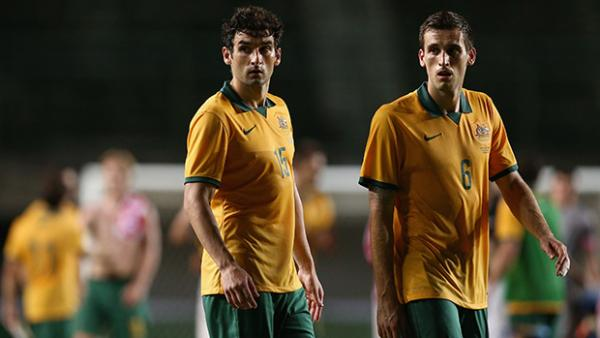 Socceroos Mile Jedinak and Matthew Spiranovic in action against Croatia.