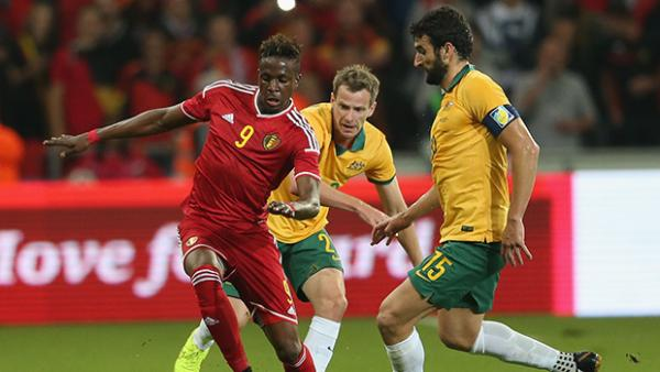 Belgium's Divock Origi shields the ball from Alex Wilkinson and Mile Jedinak.