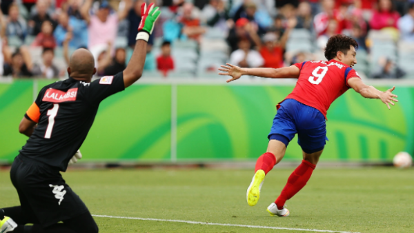 Korea Republic's Cho Young Cheol celebrates scoring the winner against Oman.