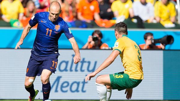 Netherland's Arjen Robben tries to weave his way past Socceroo Jason Davidson.