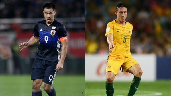 Japanese striker Shinji Okazaki and Caltex Socceroos midfielder Mark Milligan.