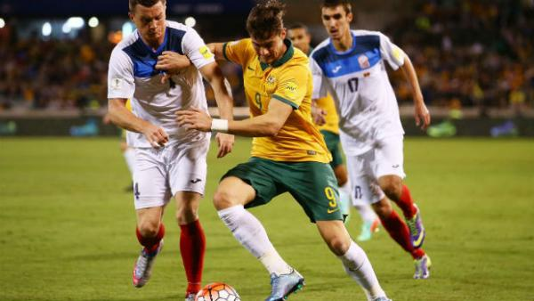 Socceroos striker Tomi Juric shields the ball against Kyrgyzstan.