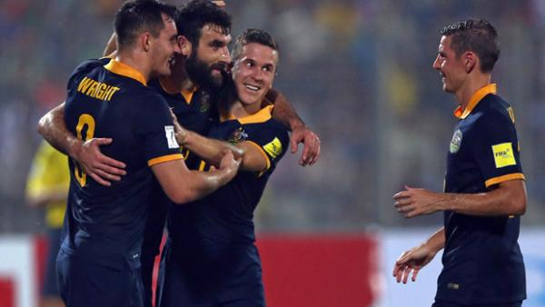 Mile Jedinak celebrates after scoring in Australia's 4-0 win over Bangladesh.
