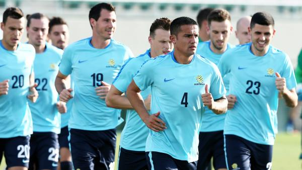 Tim Cahill leads the Caltex Socceroos on a lap during training.