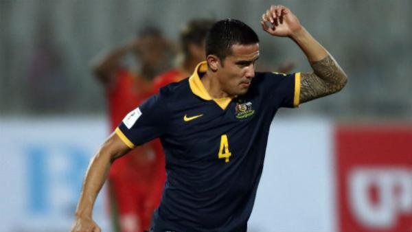 Socceroos striker Tim Cahill celebrates scoring against Bangladesh.