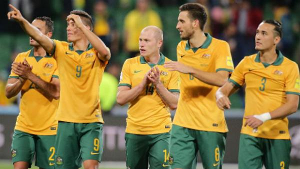 Socceroos players acknowledge the sell-out crowd at nib Stadium following their dominant victory over Bangladesh.