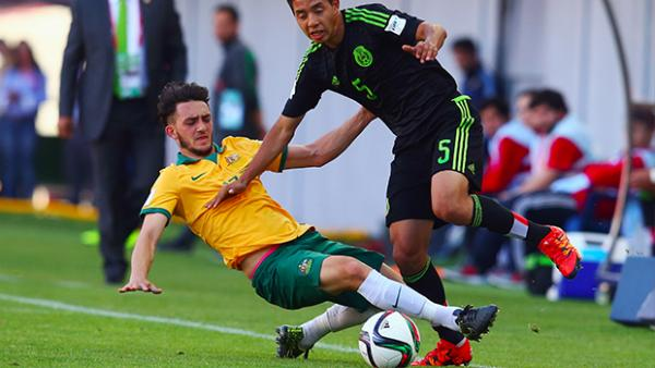 Nicholas Panetta makes a challenge against a Mexican attacker