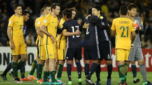 The Caltex Socceroos and Japan players shake  hands following their WCQ in Melbourne.