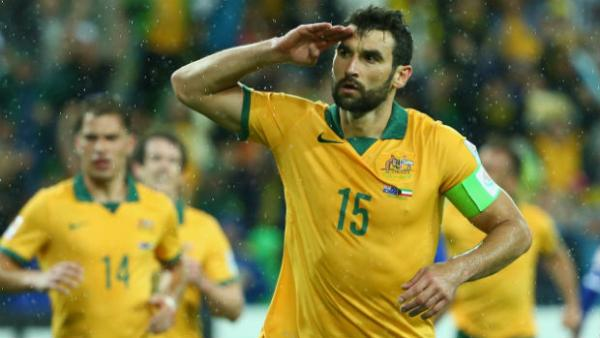 Caltex Socceroos skipper Mile Jedinak salutes Aussie supporters after scoring.