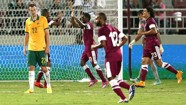 Qatar celebrate scoring the only goal of the game against the Socceroos.