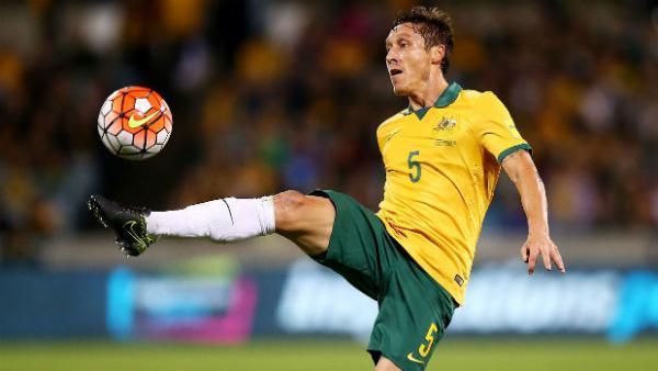 Socceroo Mark Milligan juggles the ball against Kyrgyzstan.