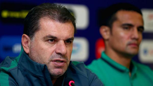 Socceroos coach Ange Postecoglou alongside Tim Cahill at Monday's press conference in Tajikistan.