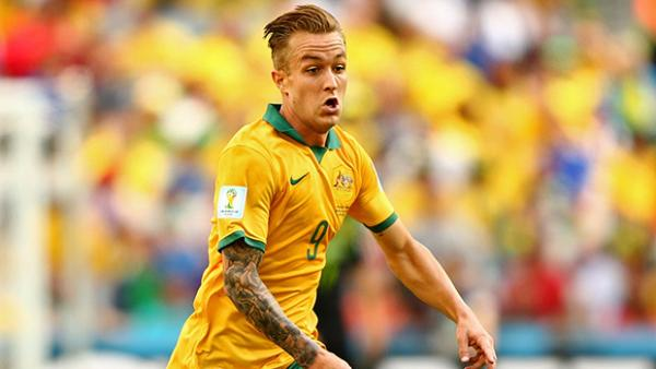 Adam Taggart in action for the Socceroos at the 2014 FIFA World Cup.