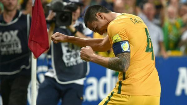 Caltex Socceroos striker Tim Cahill celebrates scoring against Jordan in a World Cup qualifier.