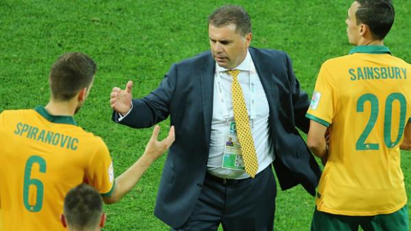 Postecoglou congratulates Socceroo defender Matt Spiranovic after Australia's 4-1 win over Kuwait.