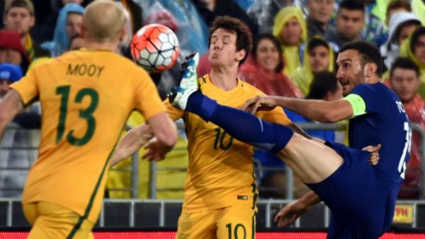 Robbie Kruse comes close to copping a boot to face from Greece midfielder Vassilelos Torosidis.
