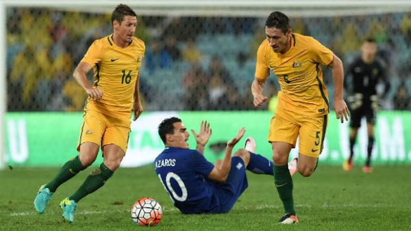 Mark Milligan goes on a darting run against Greece at ANZ Stadium on Saturday night.
