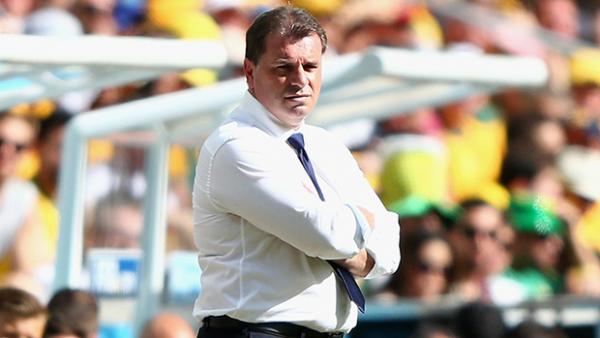Postecoglou looks on during Australia's 3-0 loss to Spain.
