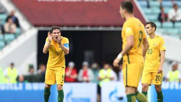 Caltex Socceroos skipper Mark Milligan tries to urge his side on in the second half.