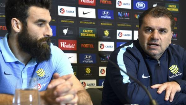 Caltex Socceroos captain Mile Jedinak and coach Ange Postecoglou at Monday's press conference in Sydney.