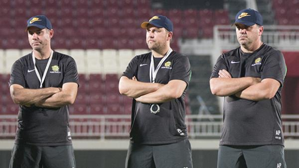 The Socceroos coaching staff monitor training in Doha.