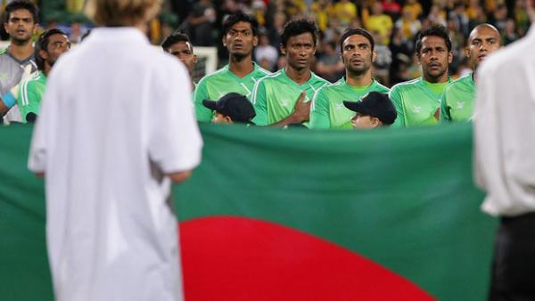 Bangladesh players lineup prior to their clash with the Socceroos in September.