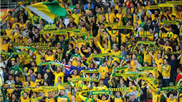 Socceroos supporters get behind the team at the Asian Cup opener in Melbourne.
