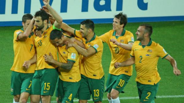 The Socceroos celebrate captain Mile Jedinak converting from the spot in the win over Kuwait.