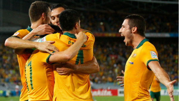 The Socceroos celebrate Matt McKay's opener against Oman.