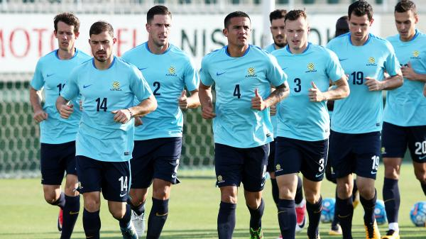 The Caltex Socceroos are put through a warm-up during a training session in Japan.