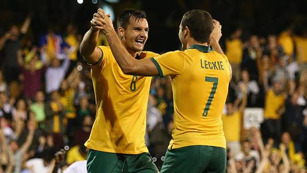 Bailey Wright celebrates with Mathew Leckie after scoring against Saudi Arabia.