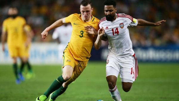 Brad Smith challenges for the ball with UAE's Abdelaziz Sanqour.