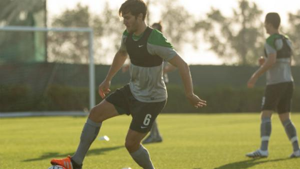 Josh Brillante takes part in a training drill at Olyroos training in Doha.