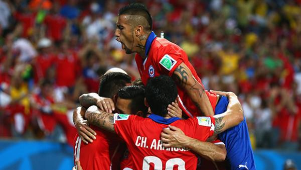Arturo Vidal celebrates with his Chilean team mates after a goal against Australia.