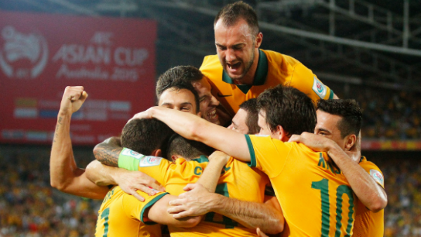 The Socceroos celebrate Matt McKay's opening goal against Oman.