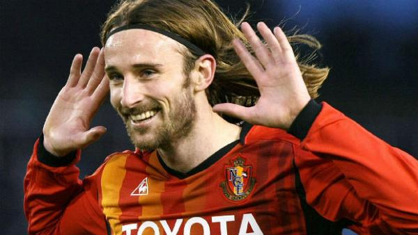Former striker Josh Kennedy celebrates scoring for J-League club Nagoya Grampus.