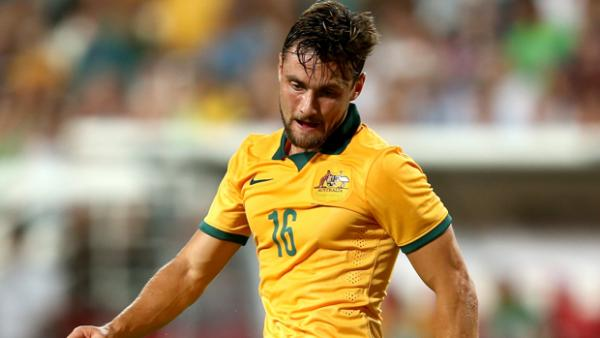 James Holland in action for the Socceroos.
