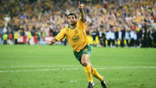 Former Socceroos striker John Aloisi celebrates converting the decisive penalty against Uruguay.