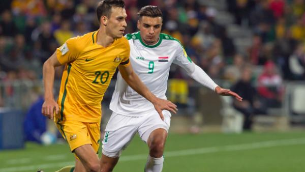 Trent Sainsbury on the ball during the Socceroos' 2-0 win over Iraq.