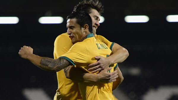 Tim Cahill celebrates with Josh Brillante after opening the scoring against Saudi Arabia.