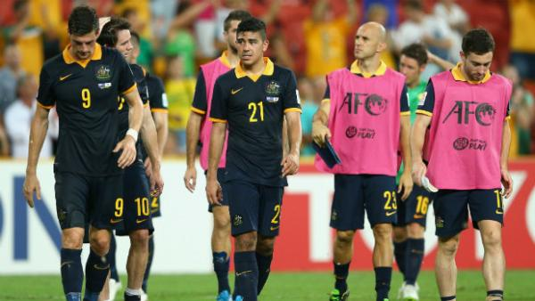 A disappointed Socceroos side depart Brisbane Stadium at full-time.