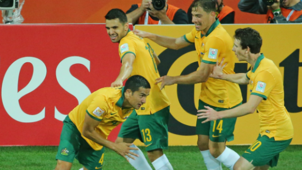 Tim Cahill celebrates his equaliser against Kuwait with Socceroo teammates.