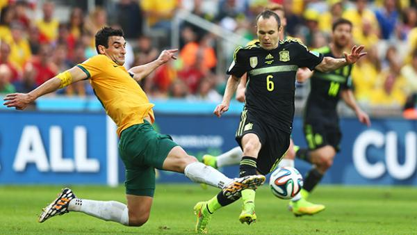 Jedinak challenges Andres Iniesta during Australia's 3-0 loss to Spain.