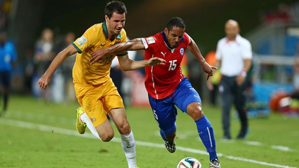 McGowan challenges Chile's Jean Beausejour in Australia's World Cup opener.