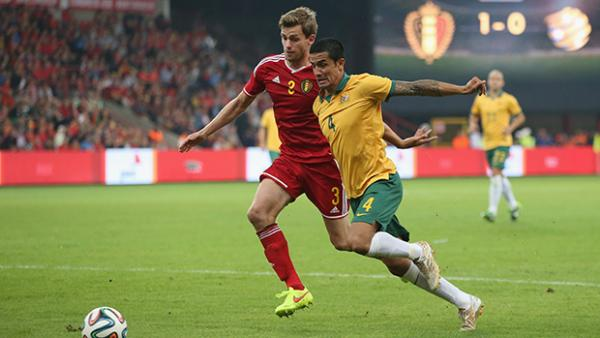 Tim Cahill wins the ball from Belgium's Toby Alderweireld.