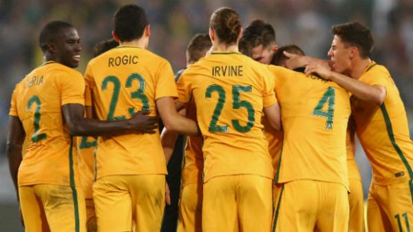 The Caltex Socceroos celebrate Mat Leckie's late winner against Greece at ANZ Stadium.