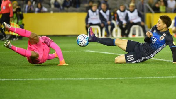 Caltex Socceroos goalkeeper Mat Ryan dives to make a save against Japan.