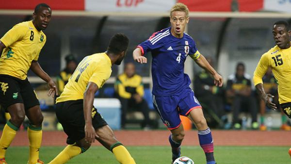 Japan's Keisuke Honda on the ball against Jamaica.